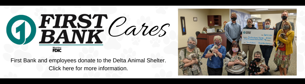 First Bank employees, shelter staff and puppies.  First Bank donates to Delta Animal Shelter